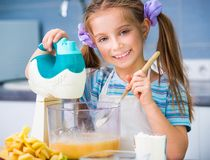 Little girl is preparing an apple pie Stock Photo