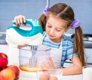 Little girl is preparing an apple pie Stock Image