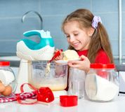 Little girl preparing cookies to valentine's day Royalty Free Stock Photography