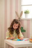 Little girl preparing for Easter - painting, drawing colored in the Room Royalty Free Stock Photos