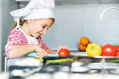 Little girl preparing healthy food Stock Images