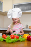 Little girl preparing healthy food on kitchen Stock Photography