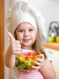 Little girl preparing healthy food and showing Stock Photos