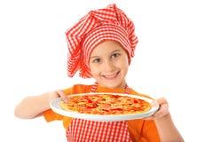 Little girl preparing homemade pizza Stock Photo