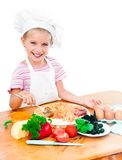 Little girl preparing a pizza Royalty Free Stock Photography