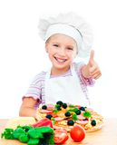 Little girl preparing a pizza Royalty Free Stock Images