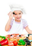 Little girl preparing a pizza Stock Photography