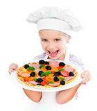Little girl preparing a pizza Royalty Free Stock Photo