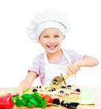 Little girl preparing a pizza royalty free stock photos