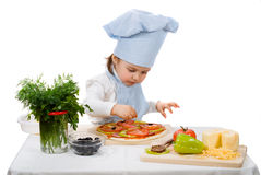 Little girl preparing a pizza Stock Images