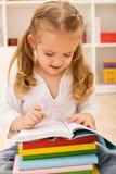 Little girl preparing for school Royalty Free Stock Image