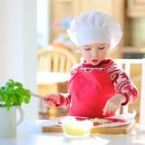 Little girl preparing tasty pizza Royalty Free Stock Photo