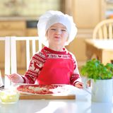Little girl preparing tasty pizza Royalty Free Stock Images