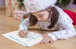 Little girl preparing The Three Wise Men Letter royalty free stock photos