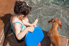 Little girl preparing to take a swim Royalty Free Stock Images