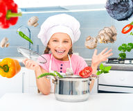 Little girl preparing vegetarian soup Stock Photography