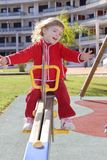 Little girl preschool playing park playground Stock Image