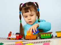 Little girl preschooler playing with toy railway Royalty Free Stock Photos