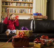 Little girl and present. A little girl happy after receiving a present Royalty Free Stock Image