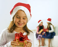 Little girl and present Stock Images