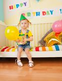 Little girl with present and baloon Stock Image