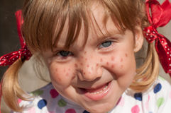 A little girl presenting Pippi Longstocking and making faces Stock Photography