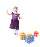 Little girl with presents Royalty Free Stock Image