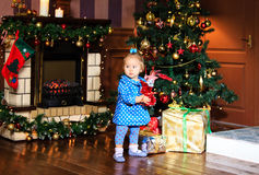 Little girl with presents at christmas Royalty Free Stock Image