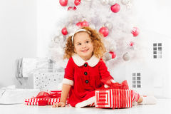 Little girl with presents under the Christmas tree Royalty Free Stock Photo