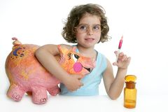 Little girl pretending be veterinary with a pig Royalty Free Stock Photos