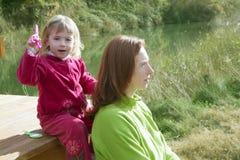 Little girl pretending mother hairdresser Stock Image