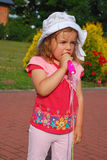 Little girl pretending a singer. Little girl with toy microphone pretending a singer outdoor Royalty Free Stock Photography