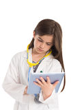 Little girl pretending to be a doctor. On white background Royalty Free Stock Images