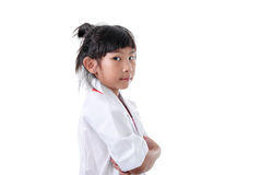 Little girl pretending to be a doctor on white. Background Royalty Free Stock Photo