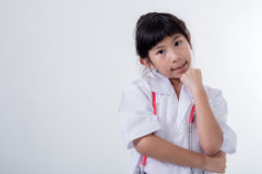Little girl pretending to be a doctor on white. Little girl pretending to be a doctor on gray background Stock Photos