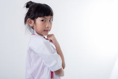 Little girl pretending to be a doctor on white Stock Photos