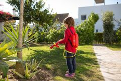 Little girl pretending to be a firefighter. Winter in Andalusia, Spain royalty free stock photo