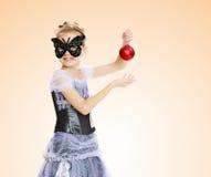 Little girl Princess carnival mask. Stock Photo