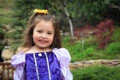 Little Girl in Princess dress. Cute little girl in a purple princess dress Stock Image