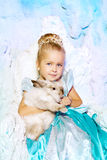 Little girl in princess dress on a background of a winter fairy Stock Photos