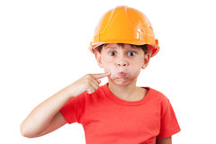 Little girl in a protective helmet. Deflates mouth Stock Photo