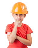 Little girl in a protective helmet. Thinking about something Stock Photography
