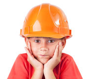Little girl in a protective helmet. Blew out his cheeks Stock Images
