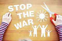 Little girl protests against the war Stock Photos