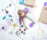 Little girl proud of her artistic creation. Beautiful little girl proud of her artistic creation Stock Image