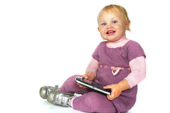 Little girl with psp Stock Images