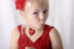 A little girl is puckering her lips Royalty Free Stock Photos