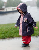 Little girl in a puddle Stock Photos