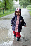 Little girl in a puddle Royalty Free Stock Image