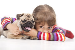 Little girl and the Pug-dog. Isolated on a white background Stock Images